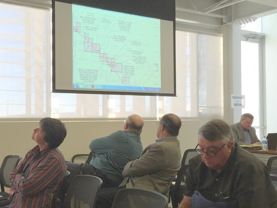 People attending an Iowa Utilities Board meeting earlier this week leaned in their chairs to look at a map showing how the proposed Dakota Access pipeline would cross through individual land parcels in Iowa.