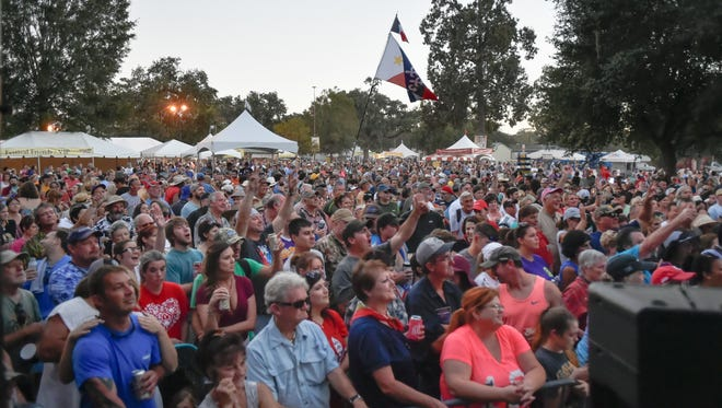 Festival goers enjoy the music from Wayne Toups at the 2016 Festivals Acadiens et Créoles at Giraurd Park. October 15, 2016.