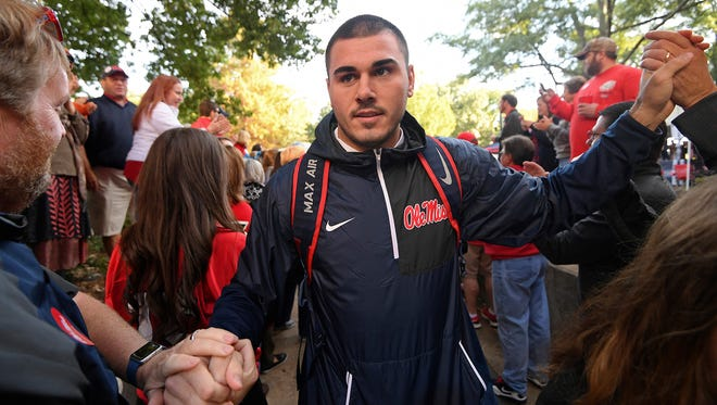 In this Nov. 5, 2016, file photo, Ole Miss quarterback Chad Kelly greets fans during the Walk of Champions in the Grove.