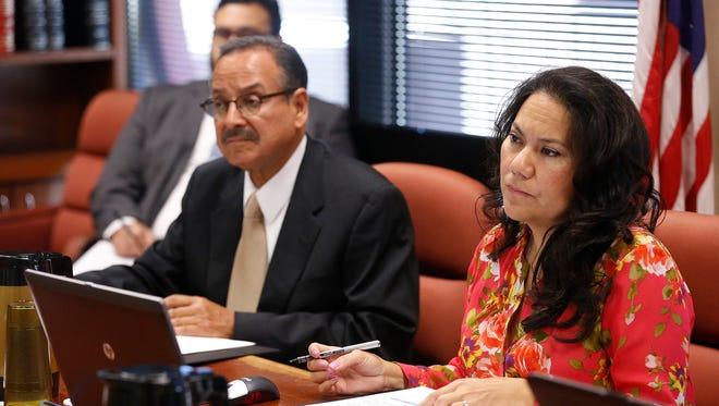 County Judge Veronica Escobar and Commissioner Carlos Leon.