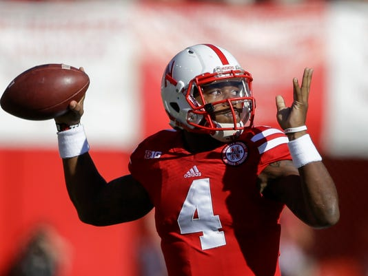 Nebraska quarterback Tommy Armstrong Jr. (4) throws against Rutgers in the first half of an NCAA college football game in Lincoln, Neb., Saturday, Oct. 25, 2014. (AP Photo/Nati Harnik)
