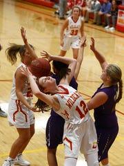Carlisle sophomore Sydney Berg tries to grab a rebound.
