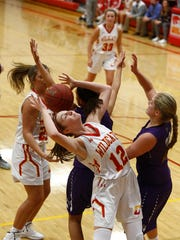 Carlisle sophomore Sydney Berg tries to grab a rebound. Carlilse beat Norwalk 56-55 in a Jan. 16 non-conference game in Carlisle.