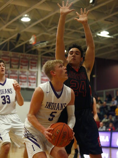 Indianola senior Quinn Vesey tries to get a look at