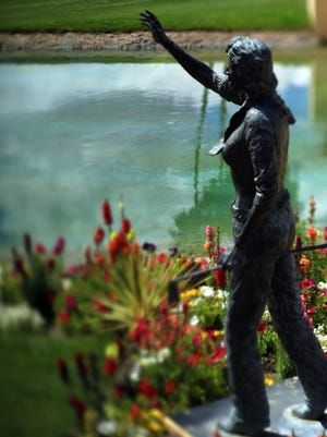 A statue of Dinah Shore is seen alongside Poppie's Pond on April 2, 2014 a day before the the LPGA tournament in Rancho Mirage then known as the Kraft Nabisco Championship began.