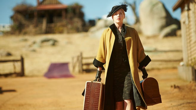 """Whether carrying luggage or carrying out revenge, """"The Dressmaker"""" (Kate Winslet) is always dressed to kill – metaphorically speaking, of course."""
