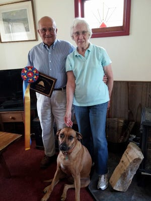 Jack Frohm, with wife Evie and dog Honey, holds his National Show Hunter Hall of Fame plaque.
