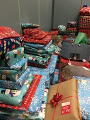 """A mountain of presents was delivered to the families supported by Dover Area High School's """"Catch-A-Star"""" program."""