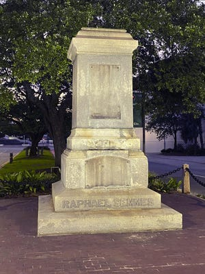 The pedestal where the statue of Admiral Raphael Semmes stands empty, early Friday, June 5, 2020 in Mobile, Ala.    The city of Mobile  removed the Confederate statue early Friday, without making any public announcements.