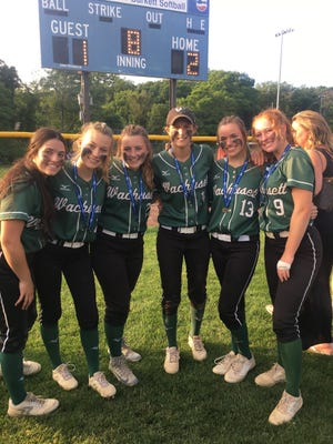 Kelsey Beaudry, No. 13, with teammates from the 2018-19 state champion Wachusett softball team.