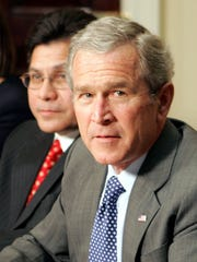 File photo of Alberto Gonzales with George W. Bush.