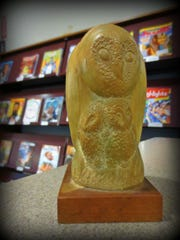 Scott Stewart returned this owl statue to the Central Library after cherishing it for 43 years.