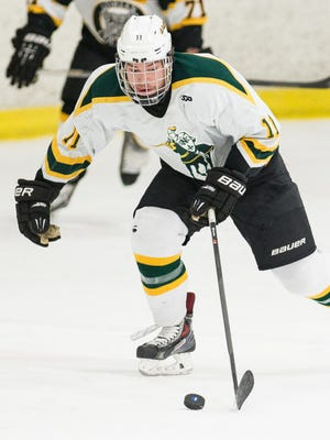 St. Norbert forward Michael Hill handles the puck during a game against Adrian College at the Cornerstone Community Center.