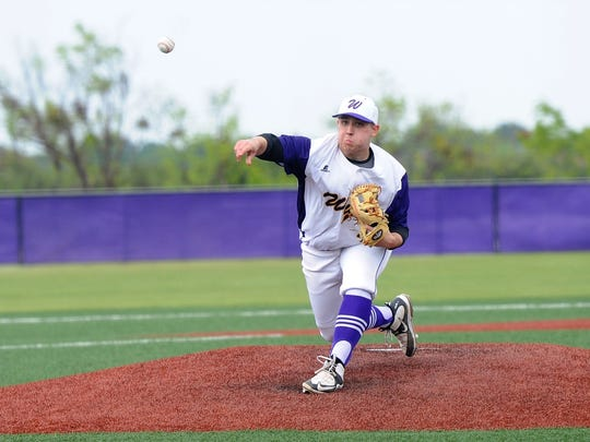 Wylie's Blake Smith (45) lets a pitch go during the
