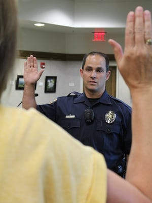 Officer Isaac Askeroth is sworn in as a member of the Cedar City Police Department.