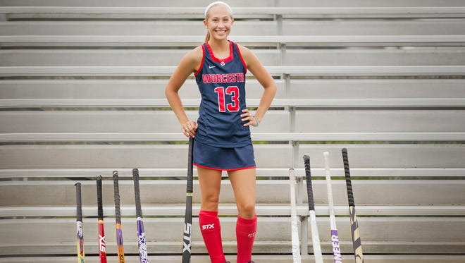Worcester Prep's Hanna Nechay poses with all of her field hockey sticks she's used. Nechay recently signed with Queens University.