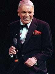 This is a Dec. 13, 1990 file photo of Frank Sinatra during a concert on his 75th birthday at the Meadowlands Area in East Rutherford, N.J., Sinatra of Hoboken, N.J., is among 15 famous New Jerseyans selected as the first inductees to the New Jersey Hall of Fame.