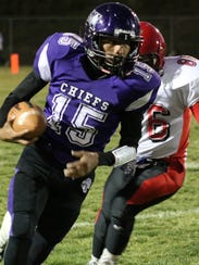 Mescalero's Matiaz LaPaz runs the ball Friday night.