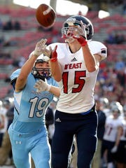 Brookfield East's Patrick Cartier catches a touchdown pass as Monona Grove's Collin Larsh tries to cover him in the WIAA Division 2 state football championship game at Camp Randall Stadium in Madison on Friday.