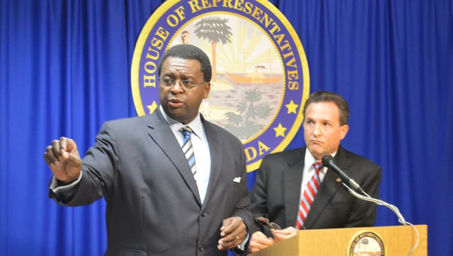 House Minority Leader Perry Thurston, D-Plantation, points to a questioner as he and Rep. Mark Pafford, D-West Palm Beach, conduct a Democratic caucus today.