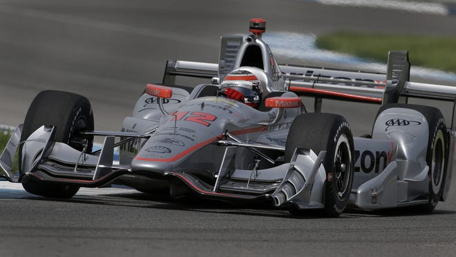 IndyCar driver Will Power rounds turn 8 during practice for the Angie's List Grand Prix of Indianapolis Thursday, May 12, 2016, afternoon at the Indianapolis Motor Speedway.