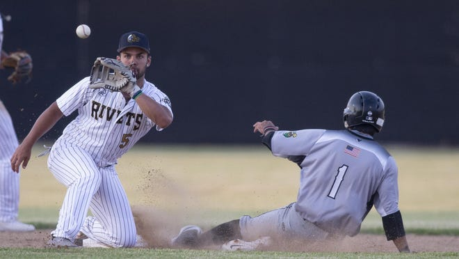 Rivets infielder Daniel Carinci attempts to tag out Loggers Kobe Kato on July 1 at Rivets Stadium. The Rivets suspended their season indefinitely on Friday after a staffer tested positive for COVID-19.