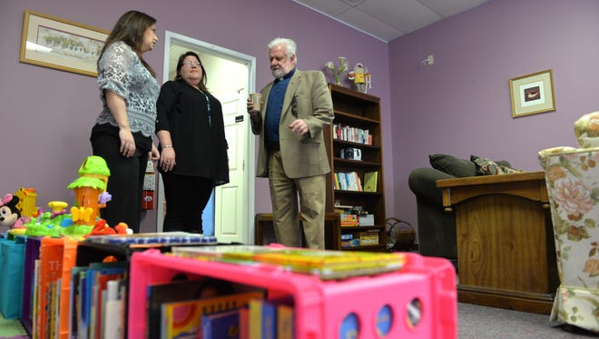 Family Promise of Cumberland County affiliate director Dawn Durkee (center) talks with board member Jill Santandrea (left), and Pastor Gary Stiegler of host church Redeemer Lutheran (right), inside the organization's newly finished Day Center, Wednesday, Apr. 13, 2016 in Vineland.