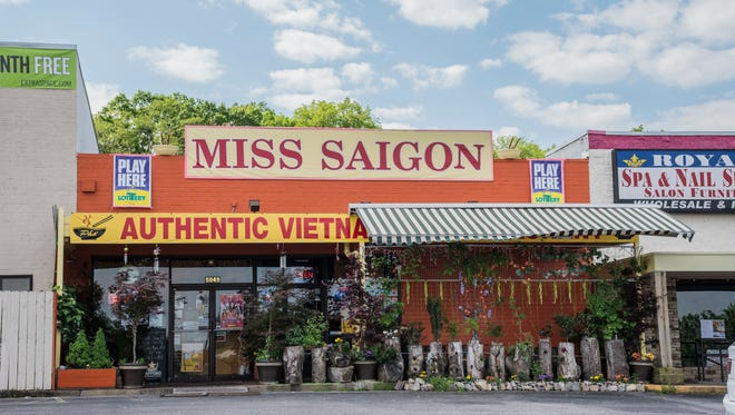 Miss Saigon, at 5847 Charlotte Pike, has a garden patio with hanging plants. Inside is dark and cozy, with shimmery mobiles dangling from the ceiling.