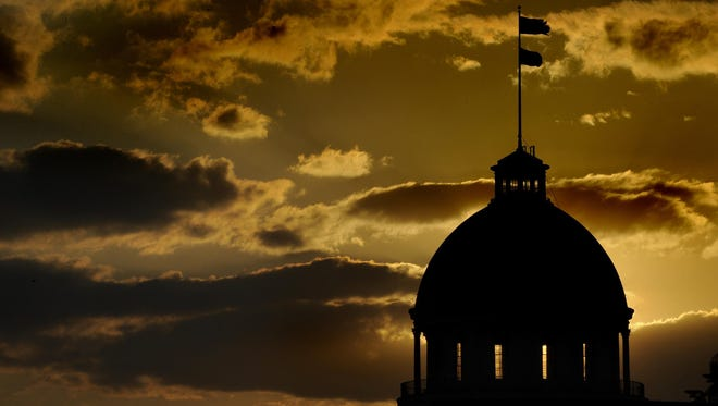 Mickey Welsh / Advertiser file The sun sets behind the state Capitol dome in Montgomery. The sun sets behind the state Capitol dome in Montgomery.