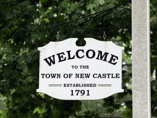"A ""Welcome to the Town of New Castle"" sign June 28,"