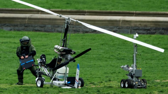 A member of a bomb squad checks a gyrocopter after a man landed on the West Lawn of the Capitol in Washington on April 15.