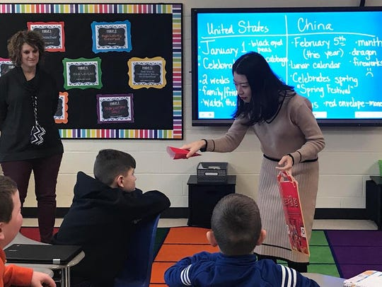 Sunny Wong, an English teacher from China, teaches