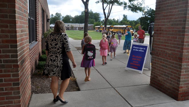 Kids go to their buses at Bartlett Elementary on the first day of school.