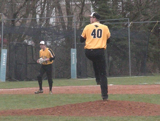 Red Lion's Tyler Burchett winds up to pitch against