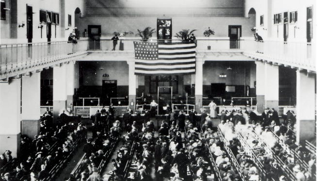 Immigrants are processed in the Great Hall at Ellis Island in the early 1900s.