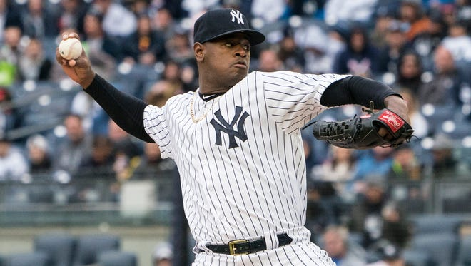 New York Yankees pitcher Luis Severino (40) delivers a pitch against the Tampa Bay Rays during the first inning at Yankee Stadium.