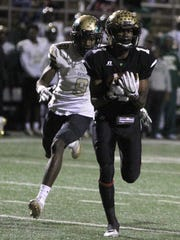Abilene's Raekwon Millsap runs into the endzone after making the catch against Desoto in the Region I-6A Division II semifinals Friday, Nov. 25, 2016, at Memorial Stadium in Wichita Falls.