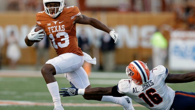 Texas wide receiver Jerrod Heard (13) runs past UTEP linebacker Alvin Jones (16) after making a catch during the first half Saturday in Austin.