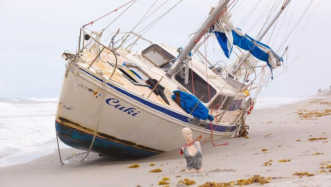 """The """"Cuki"""" sailboat mysteriously washed ashore near Melbourne Beach a little over a week after Hurricane Irma passed through Brevard."""