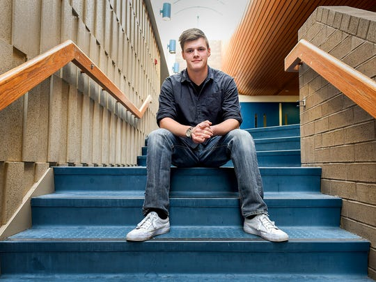 Alex Bertsch,18, has started a business that sells organic salad greens and microgreens to customers online and farmers markets in addition to his high school activities shown Wednesday, Dec. 6, at the Sartell High School.