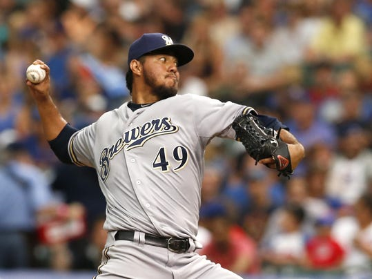 Milwaukee Brewers starting pitcher Yovani Gallardo delivers during the second inning of a baseball game against the Chicago Cubs Monday, Aug. 11, 2014, in Chicago. (AP Photo/Charles Rex Arbogast)