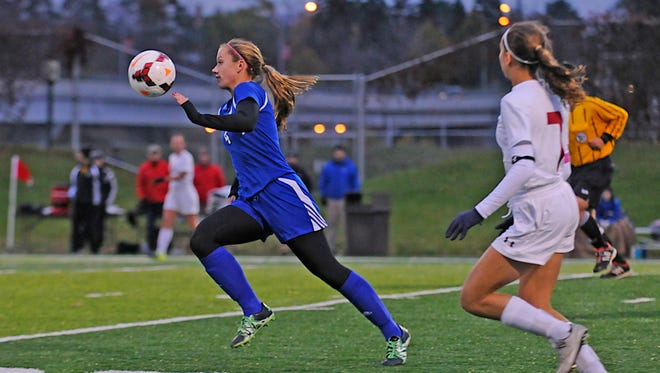 Sartell's Tessa Hager dribbles up the field during Thursday's game against Benilde-St. Margaret's at St. Cloud State's Husky Stadium.
