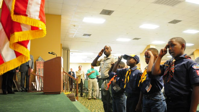 Members of Boy Scouts Pack 215 lead attendees in the Pledge of Allegiance on Wednesday during United Way of Southeast Mississippi's annual thank you banquet at Southern Oaks House and Gardens.
