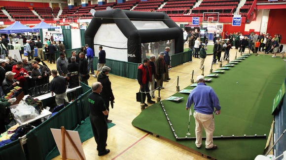 Enthusiasts attend the Golf Show, March 9, 2013, at the Westchester County Center in White Plains.