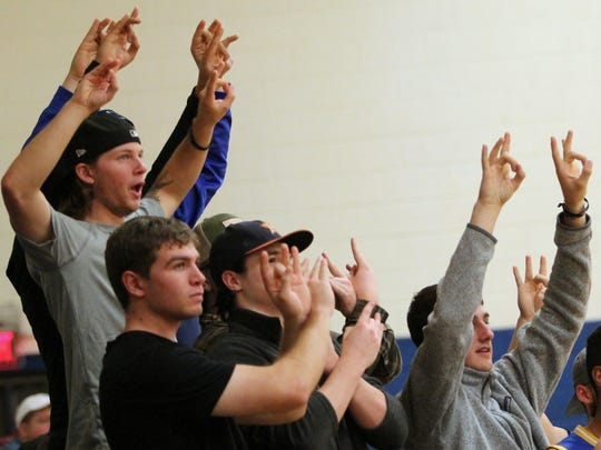 Montreat College fans provide support for a Cavaliers player at the free throw line against Bryan College.