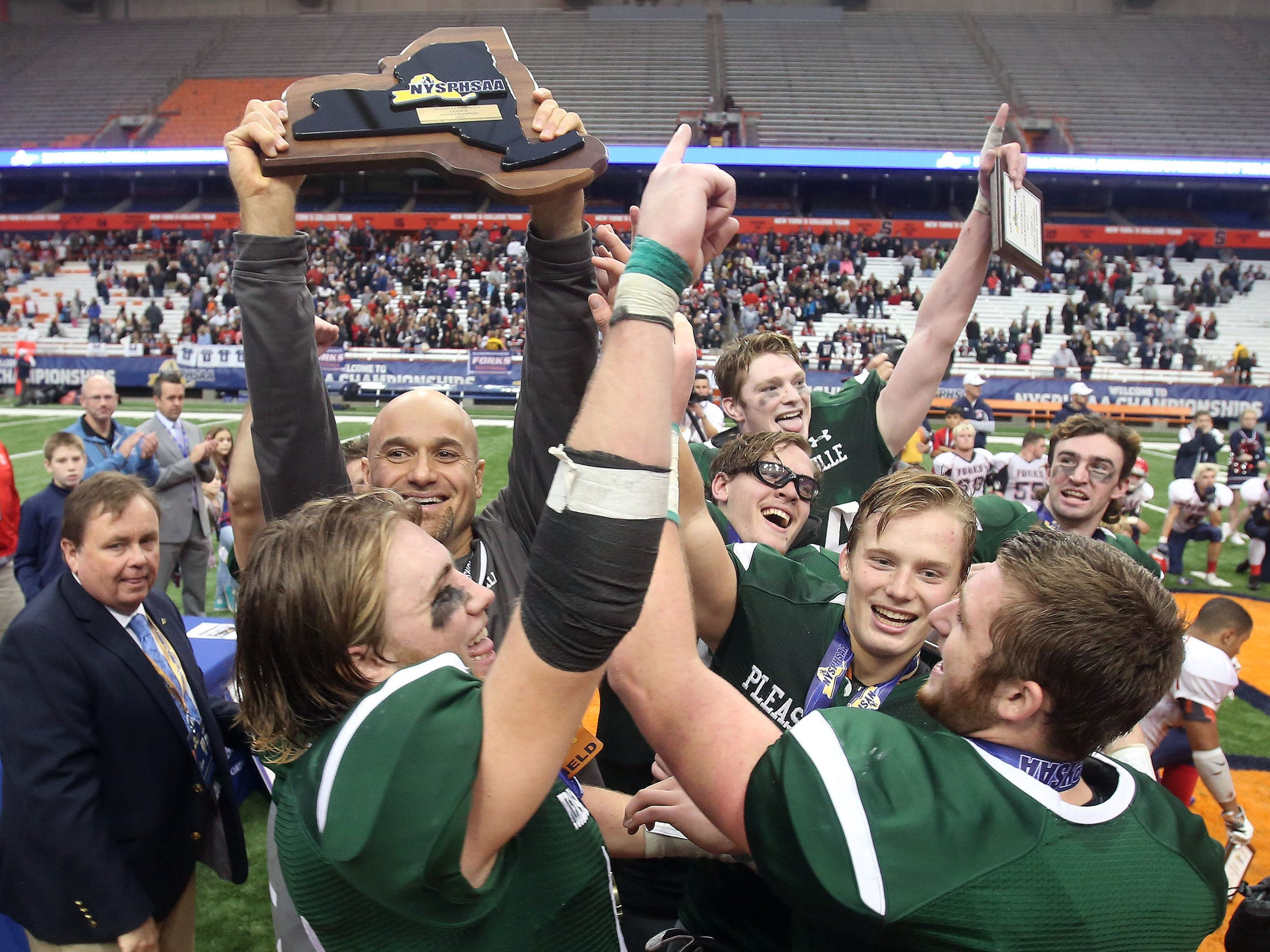 Pleasantville players celebrates their victory over