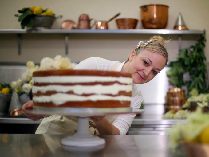 Claire Ptak, owner of Violet Bakery puts the finishing