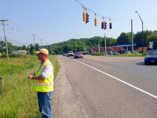 Stantec Project Manager Thad Luther at the new adaptive traffic control light at the Vermont 289 and 2A intersection in Essex on Tuesday.
