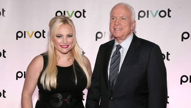 Television personality Meghan McCain, left, and her father, U.S. Senator John McCain, R-Ariz., right, attend a screening of two original series premiering on Pivot on Thursday, Sept. 12, 2013 in New York.