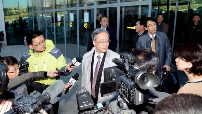 A photo released by the North Korean Central News Agency (KCNA) on Oct. 28, 2014, shows Junichi Ihara, director general of the Asia and Oceania affairs bureau of Japan's Foreign Ministry, surrounded by reporters upon his arrival at Sunan International Airport in Pyongyang, North Korea.
